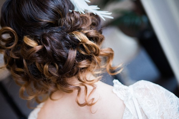 Back of bride's curled bob updo hairstyle