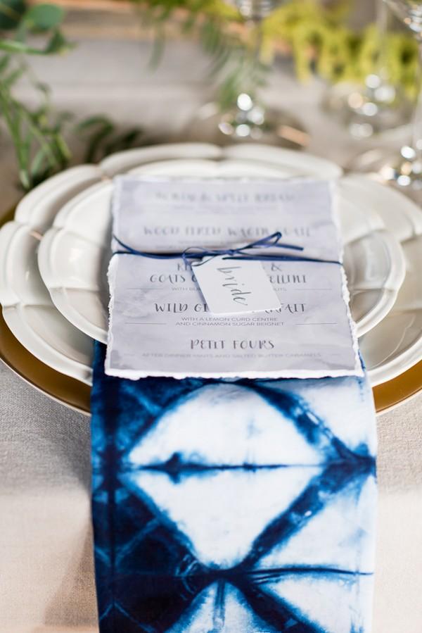 Wedding menu on top of indigo Shibori napkin