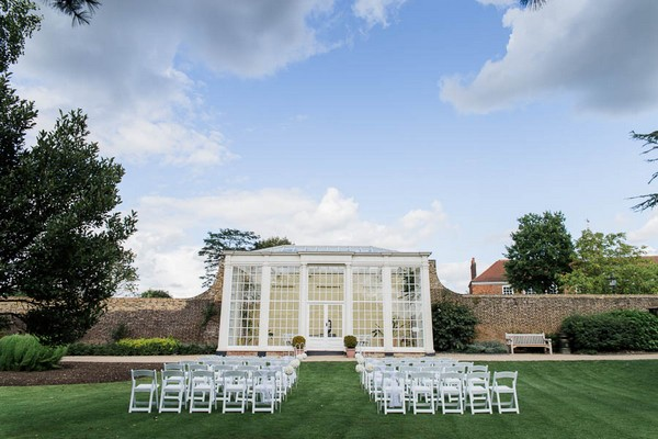 Wedding ceremony seating outside orangery at Langtons House
