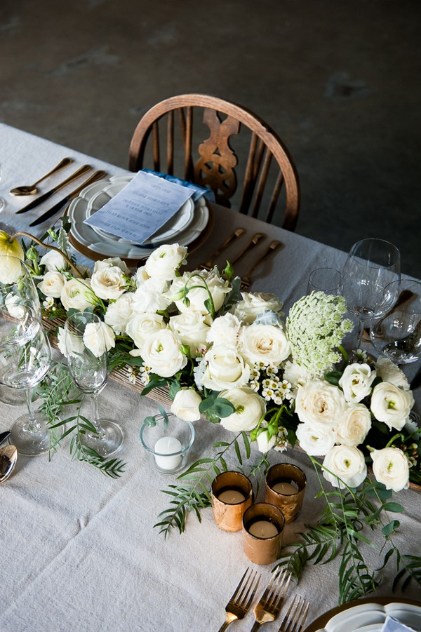 Wedding table centrepiece of white flowers