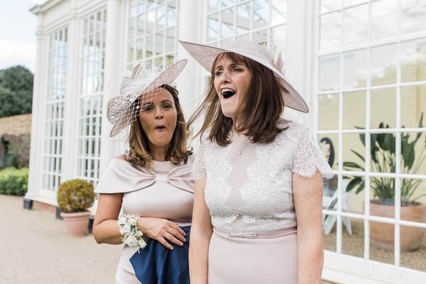 Women wearing hats at wedding
