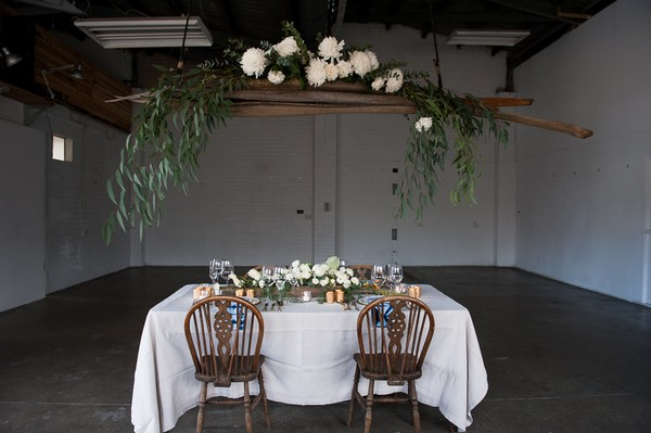 Hanging floral installation over wedding table