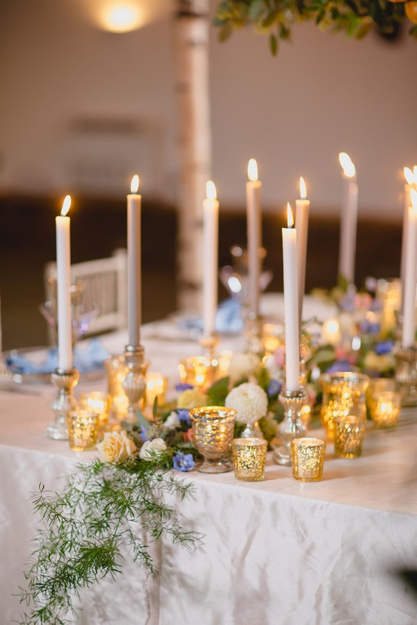 Floral and candle wedding table centrepiece