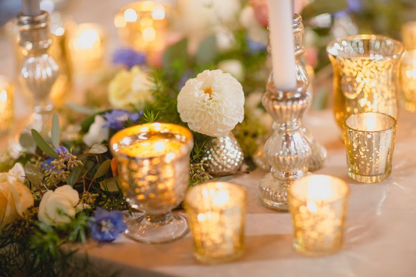 Votives, candles and flowers on wedding table