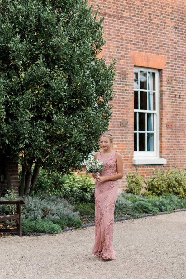 Bridesmaid wearing muted pink bridesmaid dress