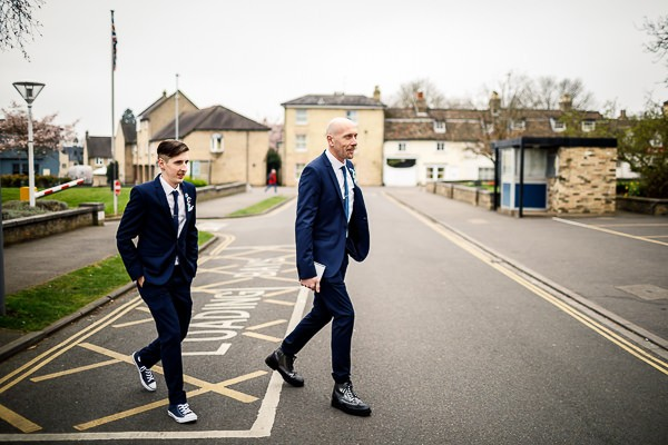 Groom and best man crossing road