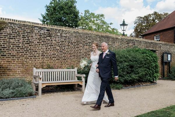 Father walking bride to wedding ceremony