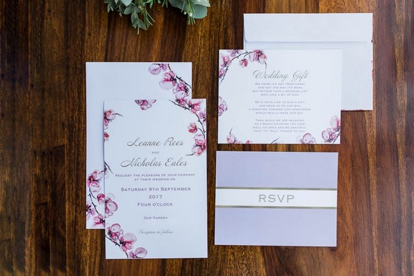 Wedding stationery with purple floral design