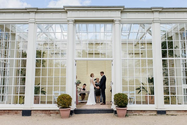 Wedding ceremony in orangery at Langtons House