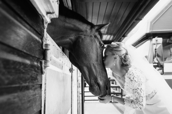 Bride kissing horse on the nose - Picture by Duncan Kerridge Photography