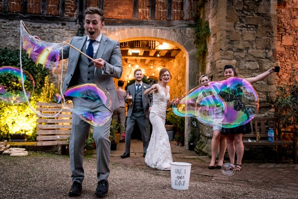 Man making giant bubbles at wedding - Picture by Matt Badenoch Photography