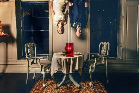 Bride and groom hanging from ceiling above dining table - Picture by Steven Rooney Photography