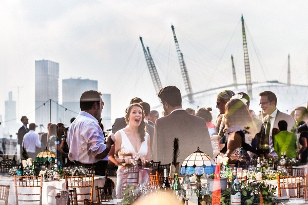Reflection in window of wedding drinks reception with O2 Arena in background - Picture by Paul Rogers Photographer