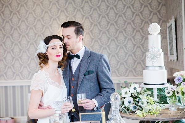 1920s bride and groom with art deco style wedding cake