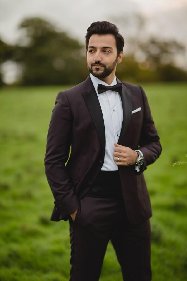 Groom wearing black tuxedo