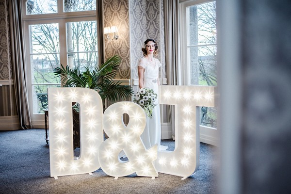 Bride behind illuminated letters