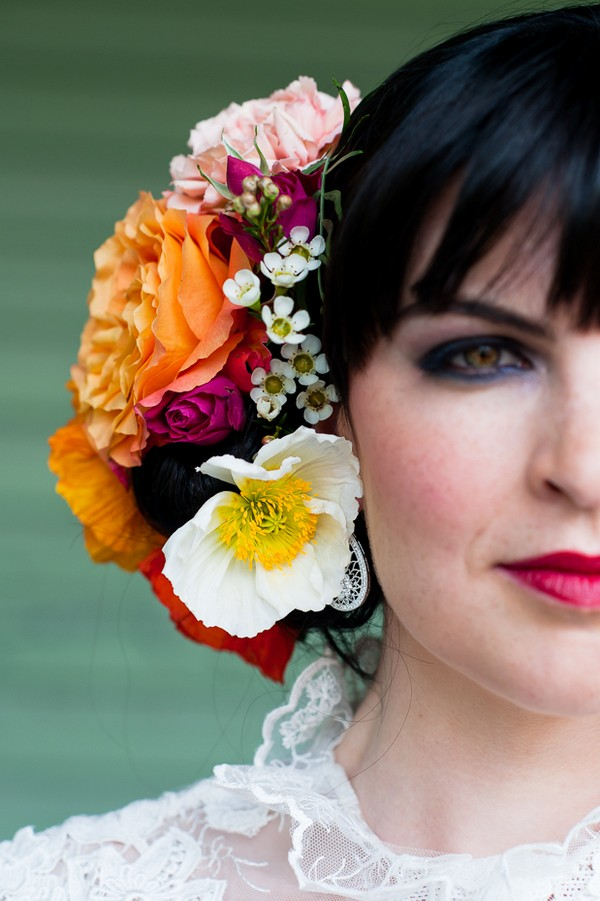 Colourful flowers in bride's hair