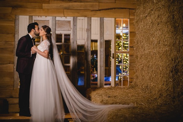 Bride and groom at hay stack at Owen House Wedding Barn