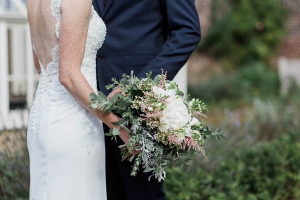 Bride's white flower and foliage bouquet