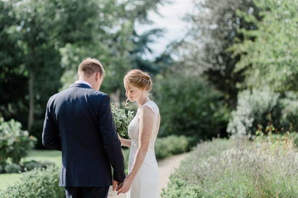 Bride and groom in gardens of Langtons House