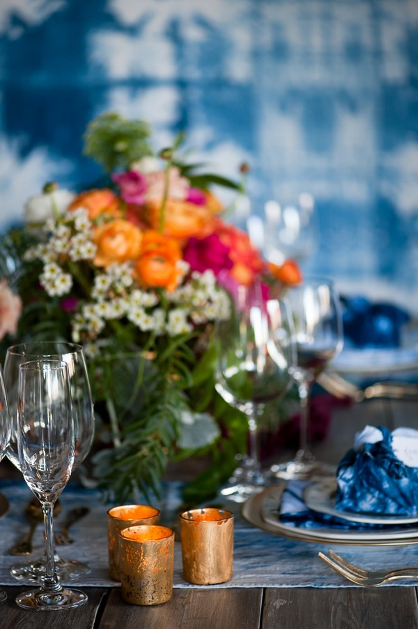 Votives and colourful flowers on wedding table