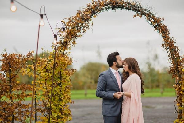 Groom kissing bride's head