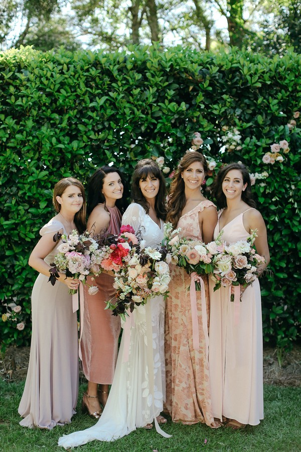 Bride with bridesmaids in mismatched dresses