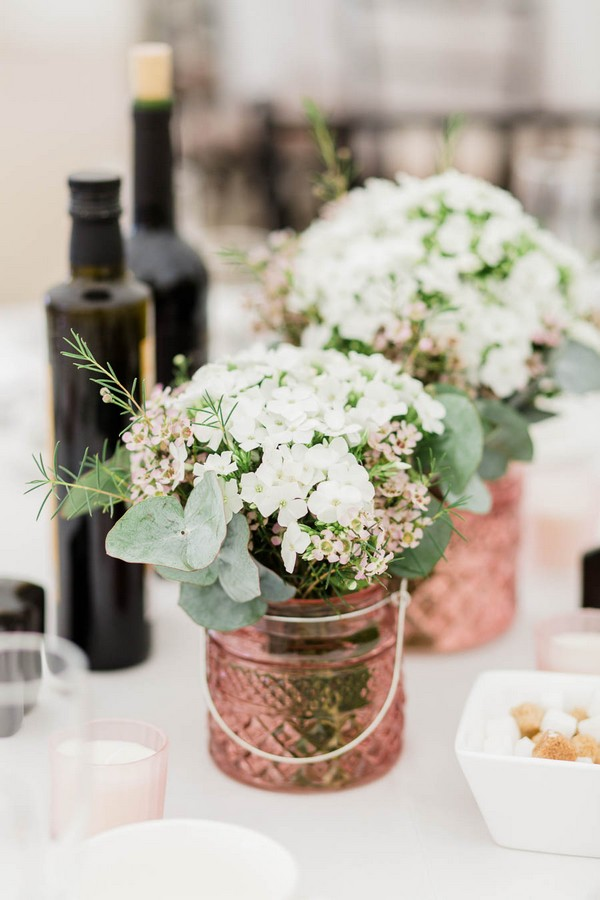 White flowers in copper pots on wedding table