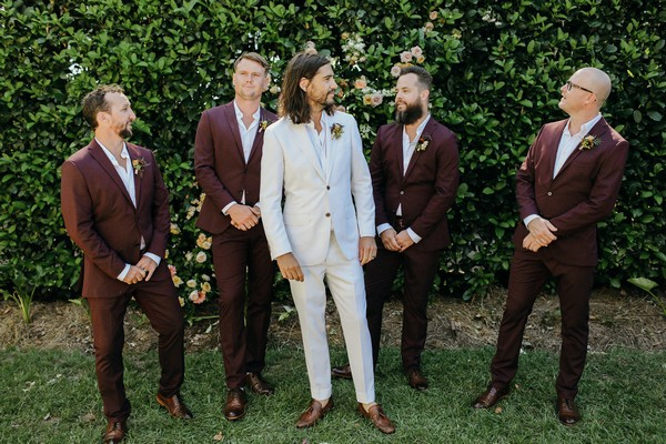 Groom with groomsmen in burgundy suits