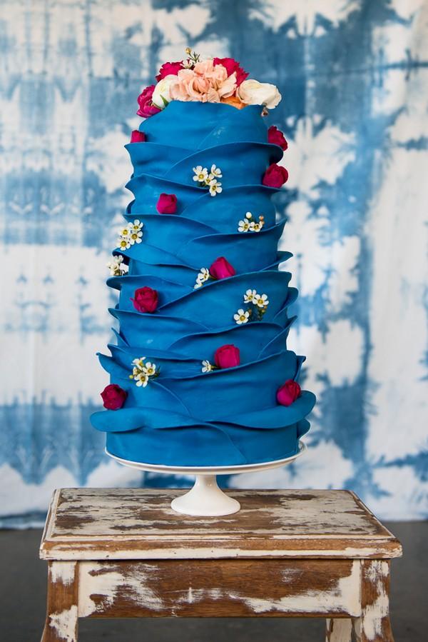 Blue ruffle wedding cake with roses