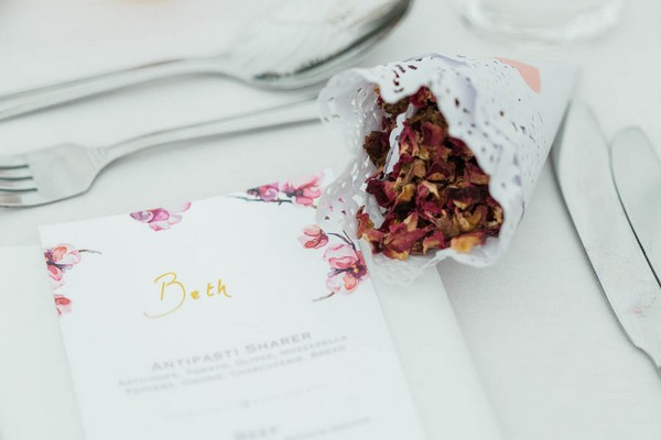 Confetti on wedding place setting