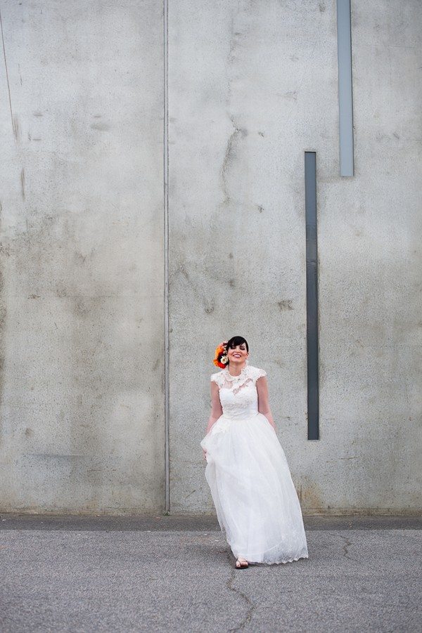 Bride standing in front of grey wall