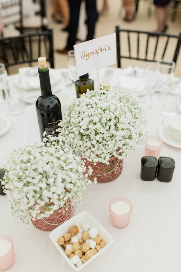 Copper pots of white flowers on wedding table