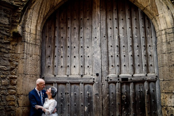 Bride and groom in front of large doors