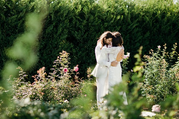Bride and groom hugging in gardens of Merribee