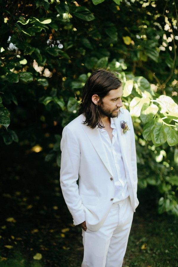 Groom wearing white suit