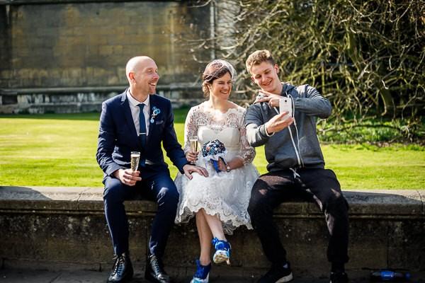 Man talking selfie with bride and groom