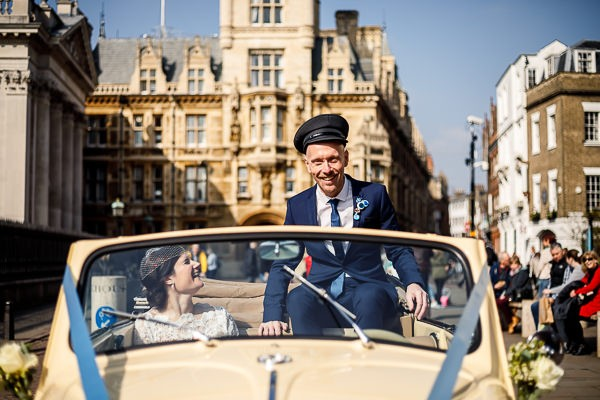 Groom in wedding car wearing driver's hat