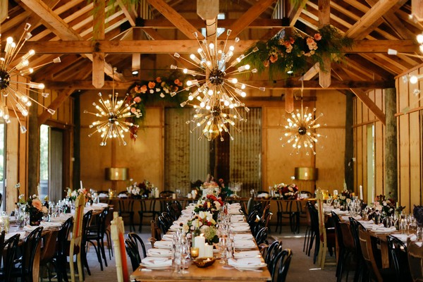 Lighting over long wedding tables at Merribee