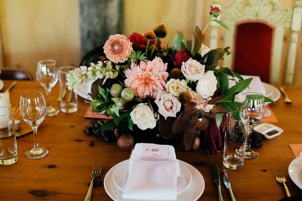 Simple wedding place setting with floral centrepiece