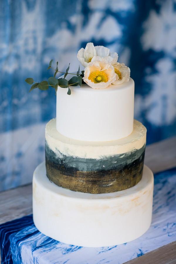 White three-tier wedding cake with watercolour stripe detail