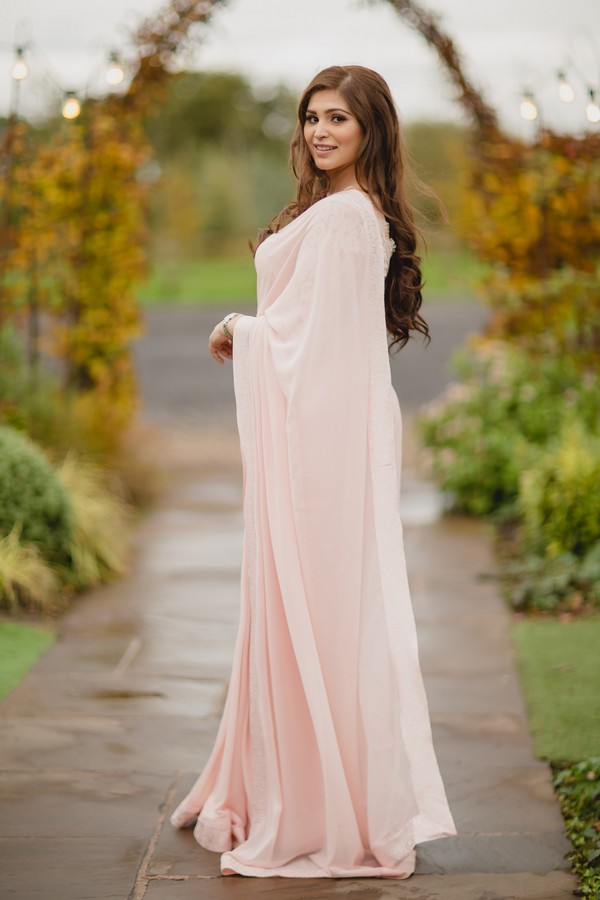 Bride in long light pink gown