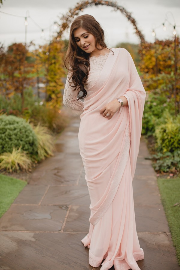Bride wearing long pink gown