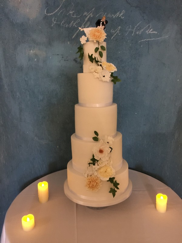 Wedding cake with flowers made by Claire's Sweet Temptations
