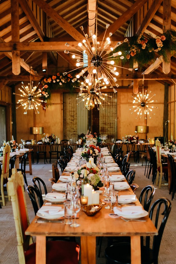 Long wedding table under funky lights