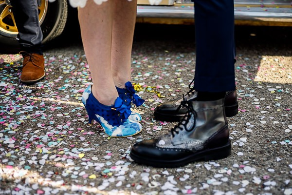 Bride and groom's feet standing in confetti