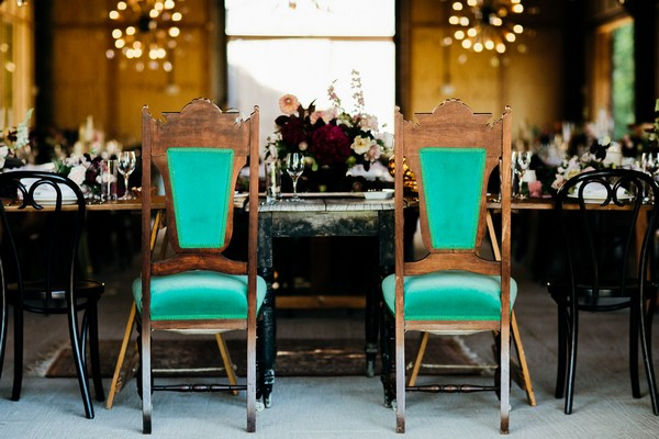 Bride and groom chairs at top table