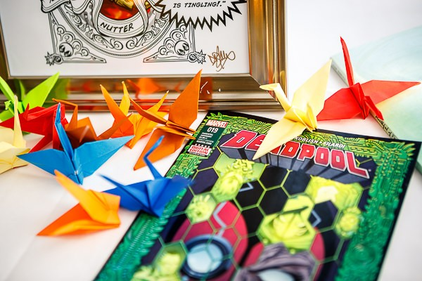 Paper cranes and comic book on wedding table