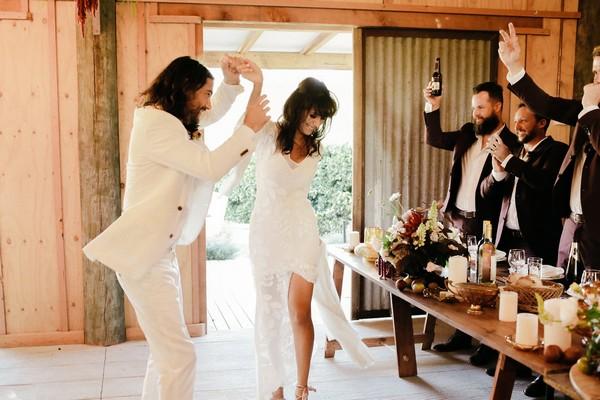 Bride and groom dancing into wedding breakfast