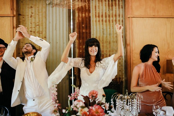 Bride with arms in the air